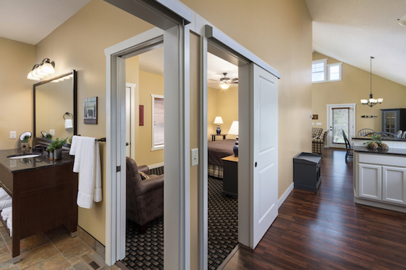 Inside view of the honeymoon cottage with bedroom, bathroom, and kitchen partial views